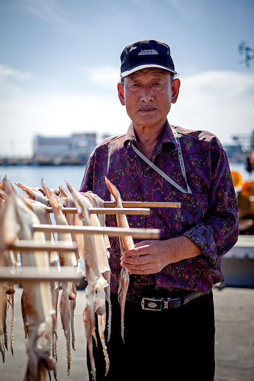 Portrait of a Korean cuttlefish seller in the harbour of Jukbeon located at the South Korean East Coast.