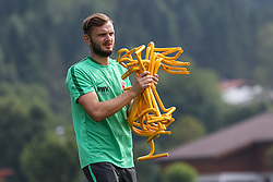 24.07.2015, Sportplatz, Walchsee, AUT, Trainingslager, FC Augsburg, im Bild Marco Grimm (Physiotherapeut FC Augsburg) r&auml;umt auf // during the Trainingscamp of German Bundesliga Club FC Augsburg at the Sportplatz in Walchsee, Austria on 2015/07/24. EXPA Pictures &copy; 2015, PhotoCredit: EXPA/ Eibner-Pressefoto/ Krieger<br /> <br /> *****ATTENTION - OUT of GER*****