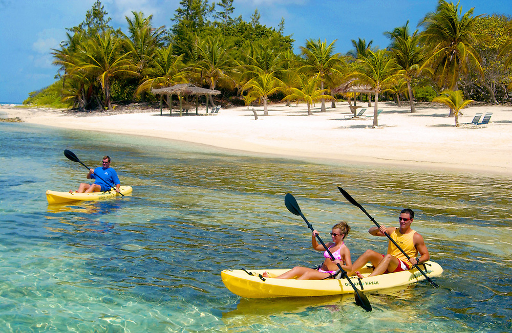 Kayaking from the palm lined beach at Brac Reef Hotel, Cayman Brac.