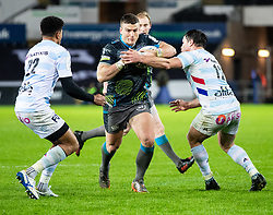 Scott Williams of Ospreys under pressure from  Henry Chavancy of Racing 92<br /> <br /> Photographer Simon King/Replay Images<br /> <br /> European Rugby Champions Cup Round 3 - Ospreys v Racing 92 - Saturday 7th December 2019 - Liberty Stadium - Swansea<br /> <br /> World Copyright © Replay Images . All rights reserved. info@replayimages.co.uk - http://replayimages.co.uk