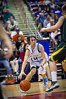 JEROME A. POLLOS/Press..Lake City's T.J. Philp looks to make a pass into the key during the first half of the T-Wolves 52-46 loss to the Lions at the state 5A boys basketball tournament Thursday at the Idaho Center in Nampa.