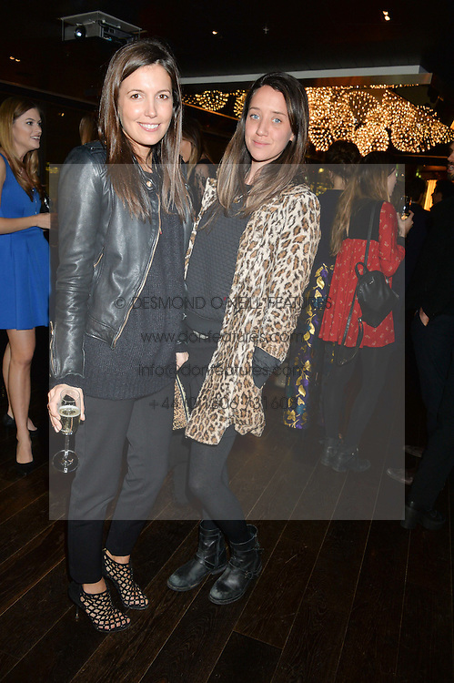 Left to right, AMANDA FERRY and INDIA LANGTON at the Launch Of Osman Yousefzada's 'The Collective' 4th edition with special guest collaborator Poppy Delevingne held in the Rumpus Room at The Mondrian Hotel, 19 Upper Ground, London SE1 on 24th November 2014, sponsored by Storm models and Beluga vodka.