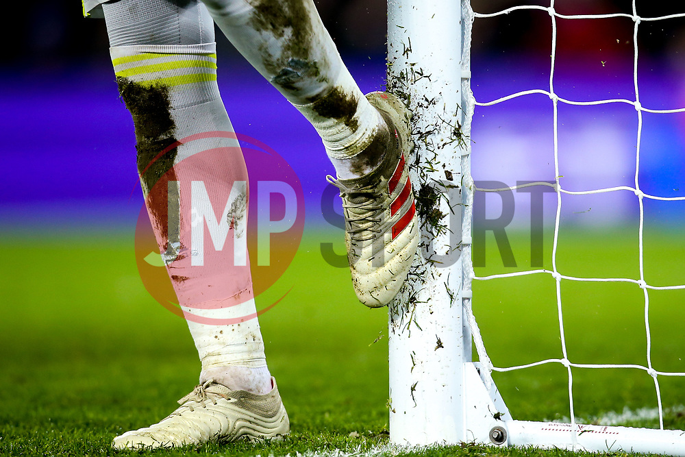 Kasper Schmeichel of Leicester City cleans his boots on the goal post - Mandatory by-line: Robbie Stephenson/JMP - 30/01/2019 - FOOTBALL - Anfield - Liverpool, England - Liverpool v Leicester City - Premier League