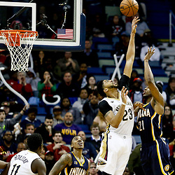 Dec 15, 2016; New Orleans, LA, USA; New Orleans Pelicans forward Anthony Davis (23) blocks a shot by Indiana Pacers forward Thaddeus Young (21) during the fourth quarter of a game at the Smoothie King Center. The Pelicans defeated the Pacers 102-95. Mandatory Credit: Derick E. Hingle-USA TODAY Sports