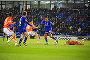 Aaron Holloway of Oldham Athletic (On loan from Wycombe Wanderers) leaves Tom Aldred of Blackpool FC trailing in his wake during the Sky Bet League 1 match between Oldham Athletic and Blackpool at SportsDirect.Com Park, Oldham, England on 15 March 2016. Photo by Mike Sheridan.
