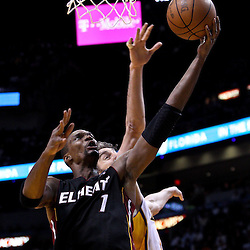 March 10, 2011; Miami, FL, USA; Miami Heat power forward Chris Bosh (1) shoots over Los Angeles Lakers power forward Pau Gasol (16) during the fourth quarter at the American Airlines Arena. The Heat defeated the Lakers 94-88.   Mandatory Credit: Derick E. Hingle