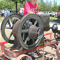 (Floyd Ingram / Buy at photos.chickasawjournal.com)<br /> Flywheeler Huck Morgan, of Catherine, Ala., adjusts his 1915 5-horsepower Fuller-Johnson flywheel at the 35th Annual Houston Flywheel Festival Saturday. Perfect weather and full slate of fun brought the crowds out to Joe Brigance Park this weekend for the Spring show.