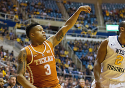 Feb 20, 2017; Morgantown, WV, USA; Texas Longhorns guard Jacob Young (3) shoots a three pointer during the first half against the West Virginia Mountaineers at WVU Coliseum. Mandatory Credit: Ben Queen-USA TODAY Sports
