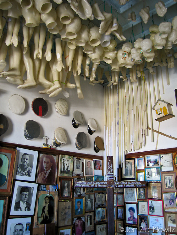 The Sala de Milagres, or Room of Miracles, at the Igreja de Nosso Senhor do Bonfim, or the Church of Our Lord of the Good End, Salvador, Brazil.  The room, adjacent to the main church, contains photos, objects, letters and votos (in the form of wax body parts) of, or from, those requesting miraculous healing, or  as testemonials from those who have recieved healings,  for which the  Senhor do Bonfim is reputed.   Photo by Jen Klewitz