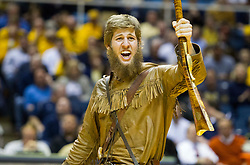The West Virginia mascot cheers during a timeout against the Texas Longhorns during the first half at the WVU Coliseum.