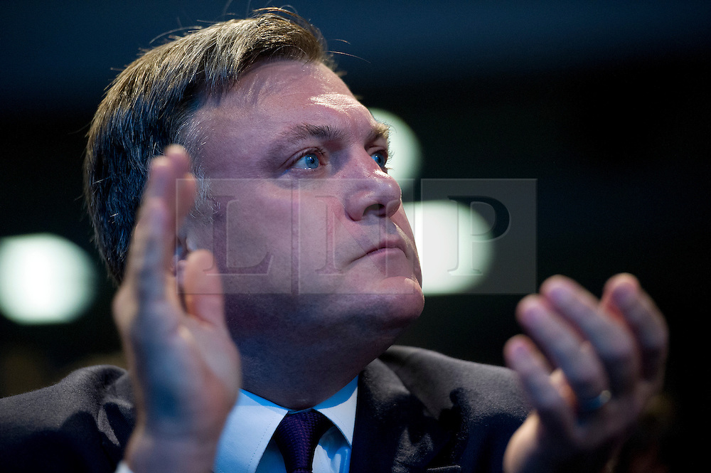 © London News Pictures. 25/09/2013 . Brighton, UK. Shadow Chancellor of the Labour Party ED BALLS listing to his wife, Yvette Cooper speak on the last day of the  2013 Labour Party Conference at The Brighton Centre. Photo credit : Ben Cawthra/LNP