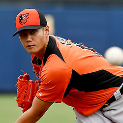 Mar 2, 2013; Port Charlotte, FL, USA; Baltimore Orioles starting pitcher Wei-Yin Chen (16) during a spring training game against the Tampa Bay Rays at Charlotte Sports Park. Mandatory Credit: Derick E. Hingle-USA TODAY Sports