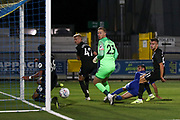 Brighton and Hove Albion defender Antef Tsoungui (88) saves shot on line from AFC Wimbledon attacker Adam Roscrow (10) during the EFL Trophy (Leasing.com) match between AFC Wimbledon and U23 Brighton and Hove Albion at the Cherry Red Records Stadium, Kingston, England on 3 September 2019.