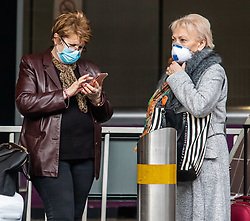 © Licensed to London News Pictures. 10/03/2020. London, UK. Passengers arrive at Heathrow Terminal 4 in masks where flights to Italy continue to run as British Airways cancels all flights to and from Italy over fears of the Coronavirus disease. Photo credit: Alex Lentati/LNP
