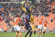 Blackpool goalkeeper Joe Lumley (28) picks the cross off the head of Bradford City striker Kai Brunker (21) during the EFL Sky Bet League 1 match between Blackpool and Bradford City at Bloomfield Road, Blackpool, England on 7 April 2018. Picture by Craig Galloway.