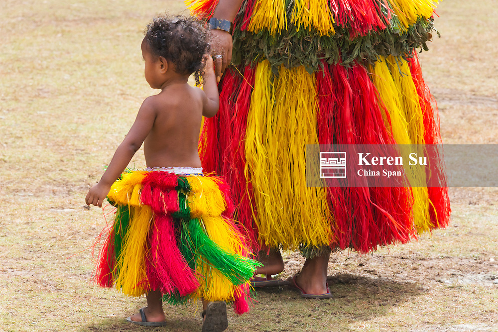 Yapese woman with little girl in traditional clothing at Yap Day Festival, Yap Island, Federated States of Micronesia