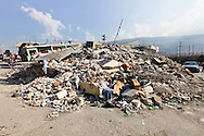 Rubble in downtown Port-au-Prince Haiti hard hit by a magnitude 7 earthquake on January 12, 2010 which caused widespread devastation, killed over 200,000 people and left over a million people homeless.