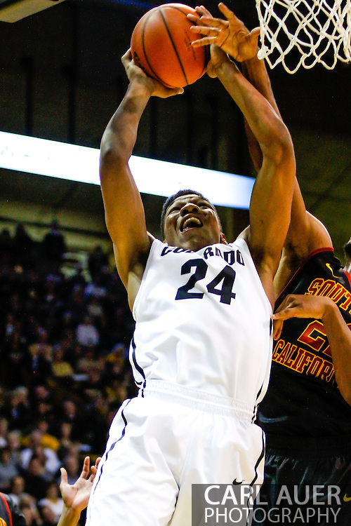 January 18th, 2014:  Colorado Buffaloes freshman guard/forward George King (24) attacks the basket in the second half of action in the NCAA Basketball game between the USC Trojans and the University of Colorado Buffaloes at the Coors Events Center in Boulder, Colorado
