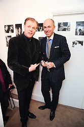 Left to right, RUSTY EGAN and DYLAN JONES at a private view of photographs by Nick Ashley held at the Sladmore Gallery, 32 Bruton Place, London on 13th January 2010.