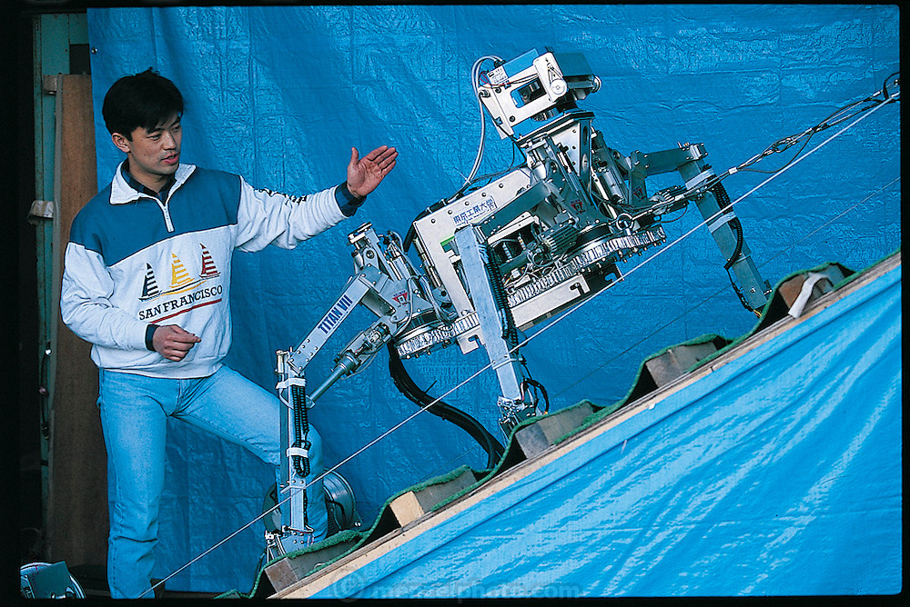 Although the Titan VII climbing robot has only four legs, its designers drew their inspiration from spiders, which have exceptional climbing skills. Built by Hideyuki Tsukagoshi, a research associate in the Tokyo laboratory of Shigeo Hirose, the machine is intended to be a mobile construction platform on steep slopes. Japan. From the book Robo sapiens: Evolution of a New Species, page 192.