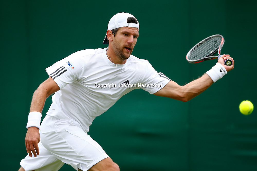 Wimbledon Championships 2013, AELTC,London,<br /> ITF Grand Slam Tennis Tournament, Juergen Melzer (AUT),Aktion,Einzelbild,<br /> Halbkoerper,Querformat,