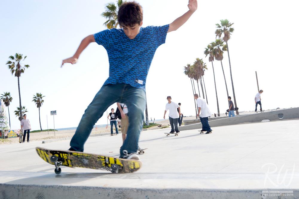 Teen Skater Grinds on Wall, Venice Beach, California