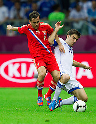 Aleksandr Kerzhakov of Russia vs Sokratis Papastathopoulos  of Greece during the UEFA EURO 2012 group A match between  Greece and Russia at The National Stadium on June 16, 2012 in Warsaw, Poland.  (Photo by Vid Ponikvar / Sportida.com)