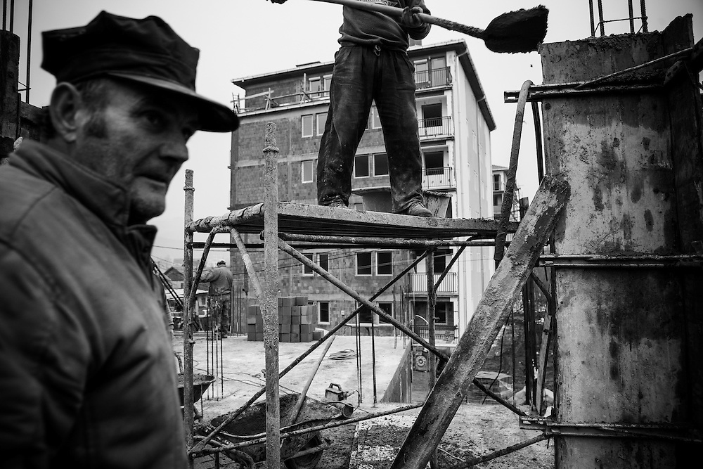 Serbian builders working on a site in north Mitrovica