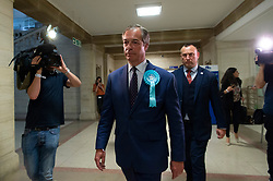 © Licensed to London News Pictures. 27/05/2019. London, UK. British Brexit party leader Nigel Farage leaves the O2 Guildhall venue after being re-elected at a Member of the European Parliament.  The Brexit Party is expected to do very well in the elections. Photo credit: Ray Tang/LNP