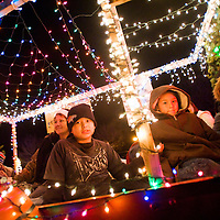 120112       Cable Hoover<br /> <br /> John Edwards, right, and Anthony Candelaria ride with their pack mates on the Cub Scouts pack 26 float during the Holiday Lights Parade in Grants Satuday.