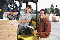 Manager with Forklift Driver at Lumber Warehouse