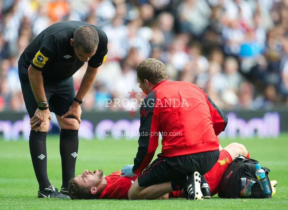 WEST BROMWICH, ENGLAND - Saturday, August 18, 2012: Liverpool's Fabio Borini receives treatment against West Bromwich Albion during the opening Premiership match of the season at the Hawthorns. (Pic by David Rawcliffe/Propaganda)