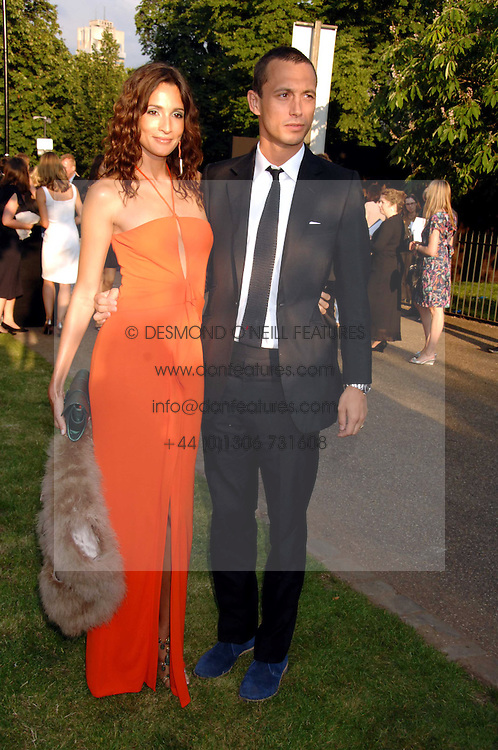 VISCOUNT MACMILLAN and ASTRID MUNOZ at the annual Serpentine Gallery Summer Party in association with Swarovski held at the gallery, Kensington Gardens, London on 11th July 2007.<br />