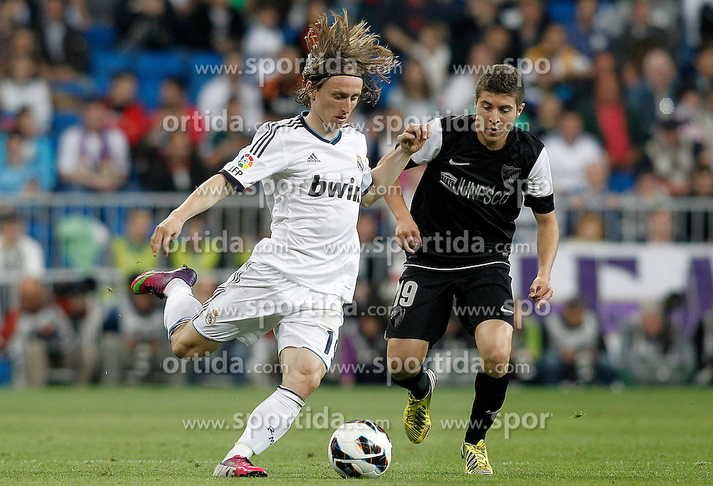 08.05.2013, Estadio Santiago Bernabeu, Madrid, ESP, Primera Division, Real Madrid vs FC Malaga, 36. Runde, im Bild Real Madrid's Luka Modric (l) and Malaga's Francisco Portillo // during the Spanish Primera Division 36th round match between Real Madrid CF and Malaga FC at the Estadio Santiago Bernabeu, Madrid, Spain on 2013/05/08. EXPA Pictures © 2013, PhotoCredit: EXPA/ Alterphotos/ Acero..***** ATTENTION - OUT OF ESP and SUI *****