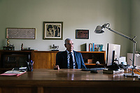 """CASARANO, ITALY - 23 JULY 2018: Lawyer Eugenio Romano (65), who represents Keope srl, a former subcontractor of the the Italian shoe company Tody's, poses for a portrait in his studio in Casarano, Italy, on July 23rd 2018.<br /> <br /> In the southern Salento region of Italy, according to the lawyer Eugenio Romano, the shoe brand Tod's  offered prices """"at least 25% lower than those applied for the same operations for shoe-makers in the Marche region. Carla Ventura, owner of KEOPE srl and former subcontractor of Tod's working as part of the brand's productions chain, is represented by lawyer Eugenio Romano. Their legal proceeding  contain accusations """"of abuse of dominant position, abuse of economic dependence in the supply contract, arbitrary termination of the commercial relationship, imposition of seriously discriminatory contractual conditions, and breach of the principles of fairness and good faith"""". Romano's conclusion is that """"the basis for this disparity of treatment is the specific commercial choice made by Tod's, which has been justified by senior executives on various occasions, asserting that in this geographical area, producer companies enjoy the so-called 'Salento flexibility.'"""