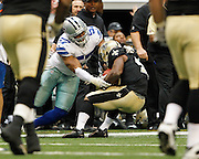 Dallas Cowboys outside linebacker Victor Butler (57) tackles New Orleans Saints running back Darren Sproles (43) at Cowboys Stadium in Arlington, Texas, on December 23, 2012.  (Stan Olszewski/The Dallas Morning News)