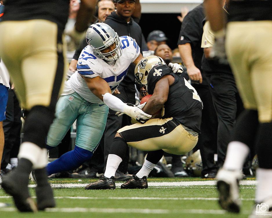Dallas Cowboys outside linebacker Victor Butler (57) tackles New Orleans Saints running back Darren Sproles (43) at Cowboys Stadium in Arlington, Texas, on December 23, 2012.  (Stan Olszewski/The Dallas Morning News)