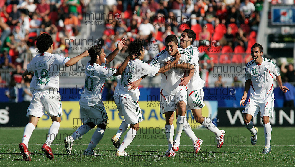 GJR37 -20070702- Toronto, Ontario,Canada.Hector Moreno(3rd from right) celebrates with his teammates after he scored to put his team up 2-0 in their match against Gambia at the FIFA U-20 World Cup on 02 July 2007 in Toronto, Ontario, Canada. Mexico defeated Gambia 3-0..AFP PHOTO/Geoff Robins