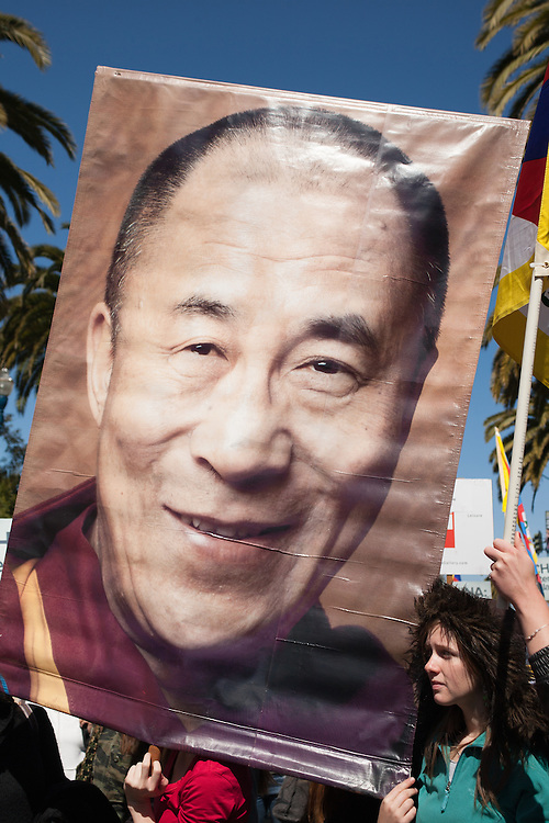 Protester against China hosting Olympic Games holds picture of the 14th Dalai Lama