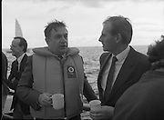 Round Europe Yacht Race.   (R61)..1987..25.07.1987..07.25.1987..25th July 1987..President Patrick Hillery started the Round Europe Yacht Race which began at Dun Laoghaire today...Photograph shows Commissioner Peter Sutherland in conversation with Mr Michael Noonan TD, Minister for Defence.