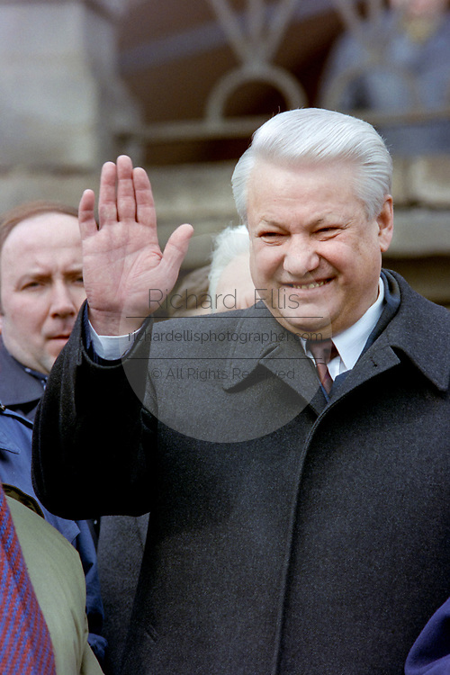 Russian President Boris Yeltsin waves to thousands of supporters gathered at a rally in Red Square March 28, 1993 in Moscow, Russia. Thousands marched through central Moscow in an effort to stop impeachment of Yeltsin by former communist deputies in the Russian Parliament.