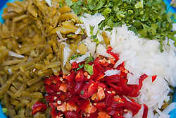 North America, Mexico, Guanajuato State, Guanajuato,  plate of onions, peppers, and cilantro.