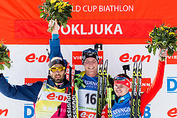 Second placed FOURCADE Martin of France, winner FERRY Bjoern of Sweden and third placed USTYUGOV Evgeny of Russia during flower ceremony after the Men 12.5 km Mass Start competition of the e.on IBU Biathlon World Cup on Sunday, March 9, 2014 in Pokljuka, Slovenia. Photo by Vid Ponikvar / Sportida