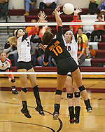 Maquoketa's Allison Vandemore (5) and Devon OConnell (20) try to block a shot by Solon's Kelsey Minrichs (10) during the WaMaC Tournament Championship game at Mount Vernon High School in Mount Vernon on Thursday October 11, 2012. Solon defeated Maquoketa 17-25, 25-15, 15-10.
