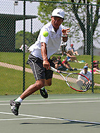 Luther's Ramesh Karki runs up on the ball to return it during his match against Coe's Victor Khristenko in the Iowa Conference Men's Tennis Championships at Veterans Memorial Tennis Center in Cedar Rapids on Saturday afternoon, May 5, 2012. (Stephen Mally/Freelance)