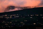 The last embers of a burning sunset caught the gable ends of the hillside town of Groeslon on the hillside below the imposing Nantlle Ridge. The clouds were on fire, billowing and swirling, hiding and revealing the majestic hills behind. <br /><br />And then within perhaps a minute, a huge fire blanket of cloud on the horizon suffocated the intense flames, and the colours were gone for the night.