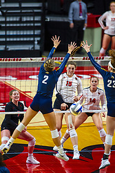 BLOOMINGTON, IL - September 15:  Monica Miller strikes the ball towards Hannah Vanden Berg and Elizabeth Orf during a college Women's volleyball match between the ISU Redbirds and the Marquette Golden Eagles on September 15 2019 at Illinois State University in Normal, IL. (Photo by Alan Look)