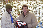 Atlanta Falcons Running Back sensation Jarius Norwood stops by the set of  Extreme MakeOver Home Edition to see Ty and drop of some Atlanta Falcons football jerseys for the Jones family in Brandon, Mississippi Jan,31,2007.(Photo/©Suzi Altman/ABC Television)