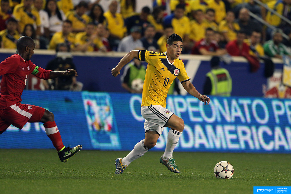 James Rodríguez, Colombia, in action during the Columbia Vs Canada friendly international football match at Red Bull Arena, Harrison, New Jersey. USA. 14th October 2014. Photo Tim Clayton