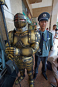 Wangfujing Dajie shopping street and pedestrian zone. Security guard of a shopping center with fake knight.